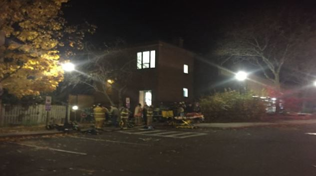 Officials on scene investigating fire at Amherst apartment complex.