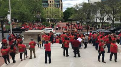 Hundreds rally outside Springfield City Hall in support of public school funding.