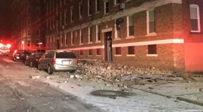 Holyoke officials investigating after roof of apartment building partially collapses.