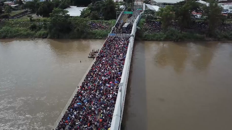 Tense standoff as migrants pack bridge on Mexico's southern border