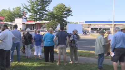 Dozens rally outside Springfield church to protest border camp conditions.