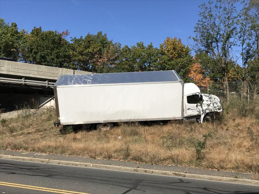 Box truck goes 'airborne' off Pike and crashes in Ludlow