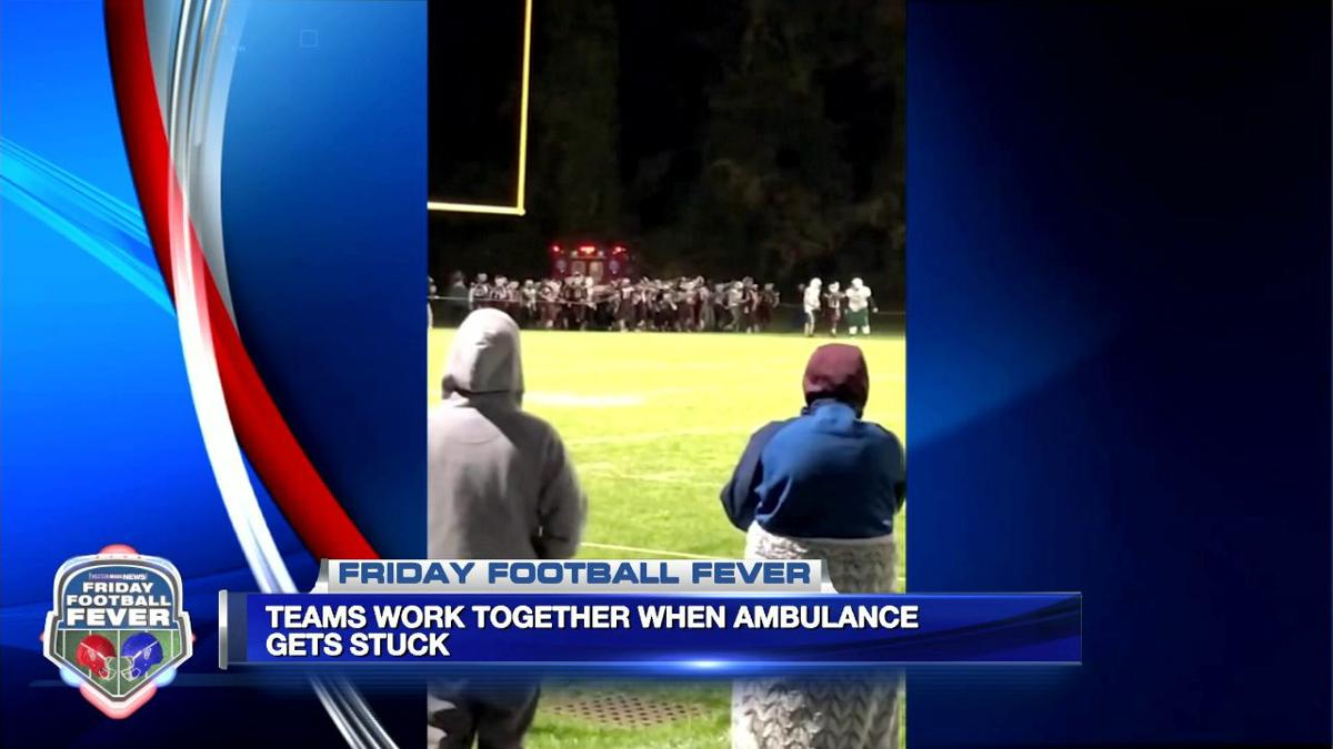 Football teams work together when ambulance gets stuck
