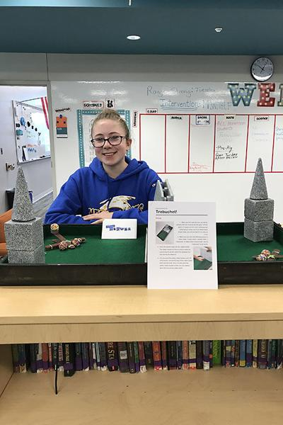 "Sophia Thibodeaux placed first in a nation wide rubber band contest with her invention, the game, ""Trebuchet!"""