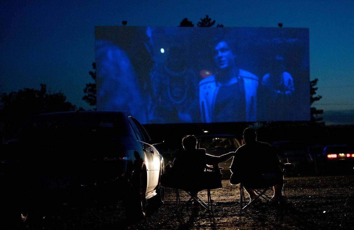 """Moviegoers relax in camp chairs at they watch """"Solo: A Star Wars Story"""" on one of the two big screens at Aut-O-Rama Drive-In Theatre in North Ridgeville. The theater, which opened in 1965, added a second screen in 1972."""