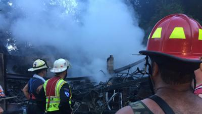 Firefighters recount effort to save man from burning home