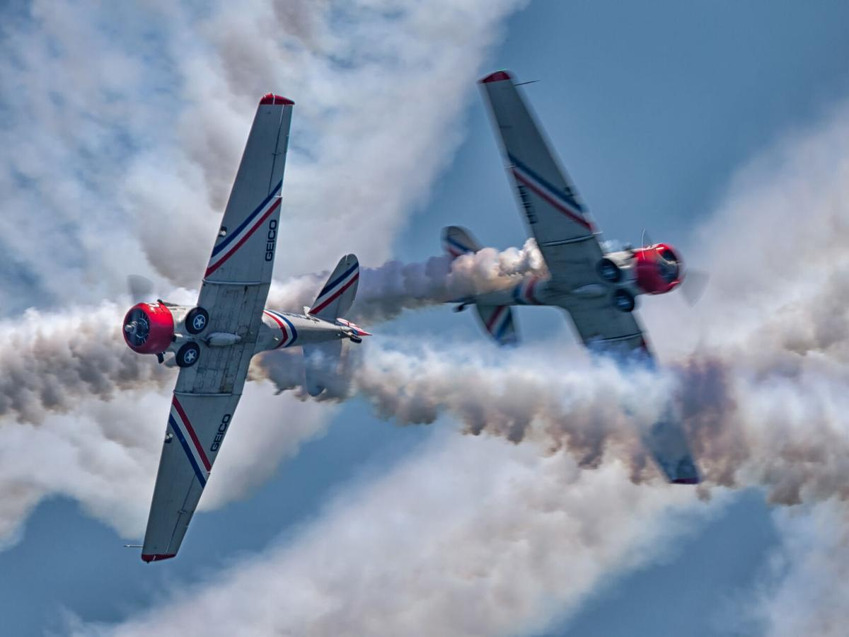 The solo aircraft from the GEICO Skytypers Air Show Team in a close head-on pass.