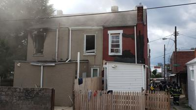 Firefighter taken to hospital from house fire in Reading