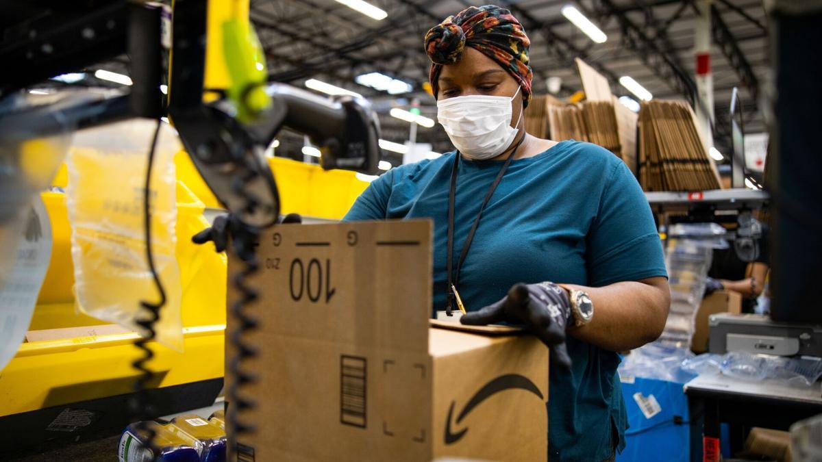 Amazon employee in fulfillment center