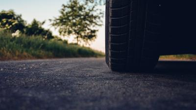 generic car tire on asphalt pavement road street