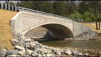Opening of new bridge highlights challenges for smaller towns in completing replacement projects