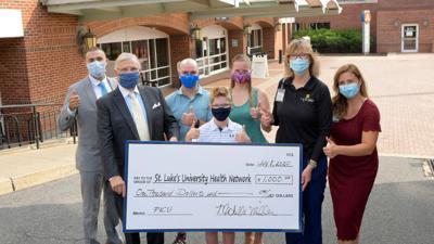 Boy helps raise money for local hospital