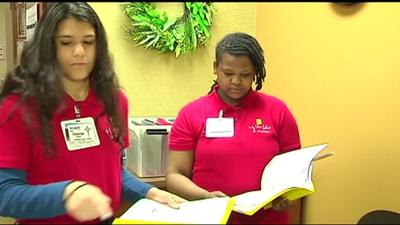 Students trade the classroom for work one day a week as part of St. Luke's program