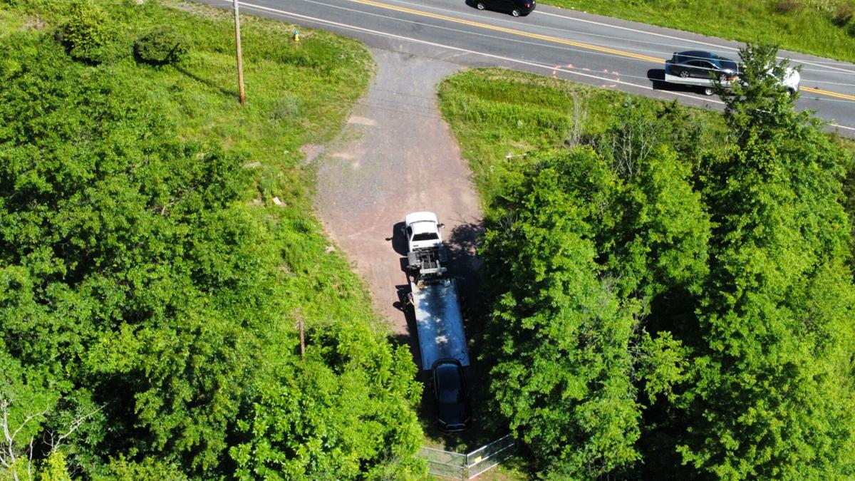 vehicles towed Richland Township Bucks County homicide scene drone