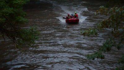 Pregnant mom, child die after car swept away by floodwaters
