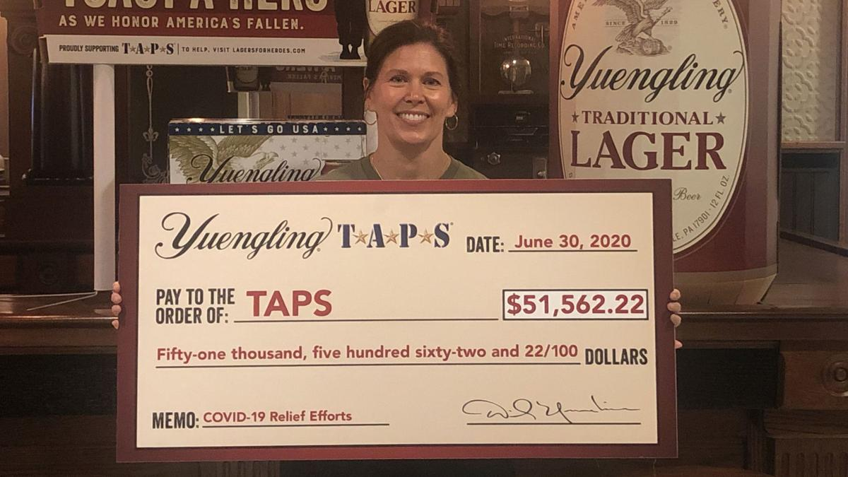Debbie Yuengling with check for TAPS