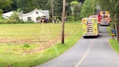 Man found dead in SUV after crash into garage, collapse