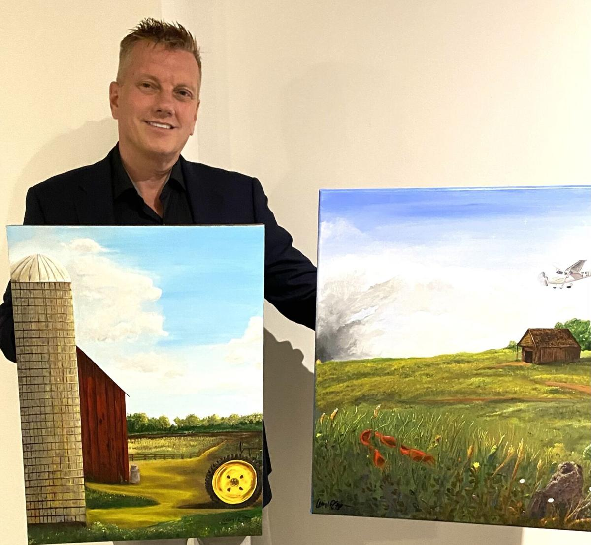 Craig Biorn with his original book cover paintings he painted for his books, Bilan's Journey of Hope and Bah Bah for Barbara