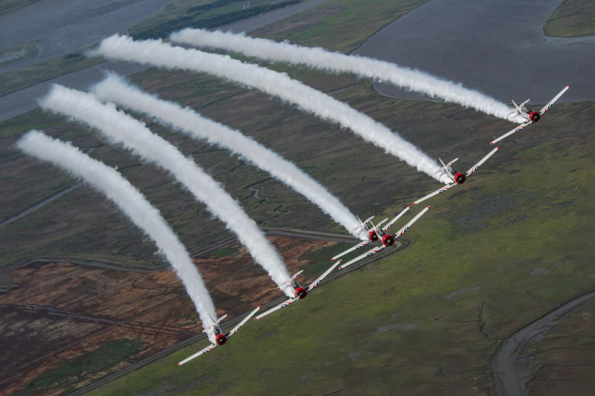 The GEICO Skytypers in a six-ship delta formation. The team will perform an 18-minute low-level precision-flying demonstration during the 2021 Ocean City Air Show.