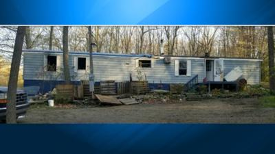 Man charged in arson of Monroe mobile home