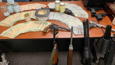 Monroe man charged after investigators seize $250K worth of drugs, 15 guns