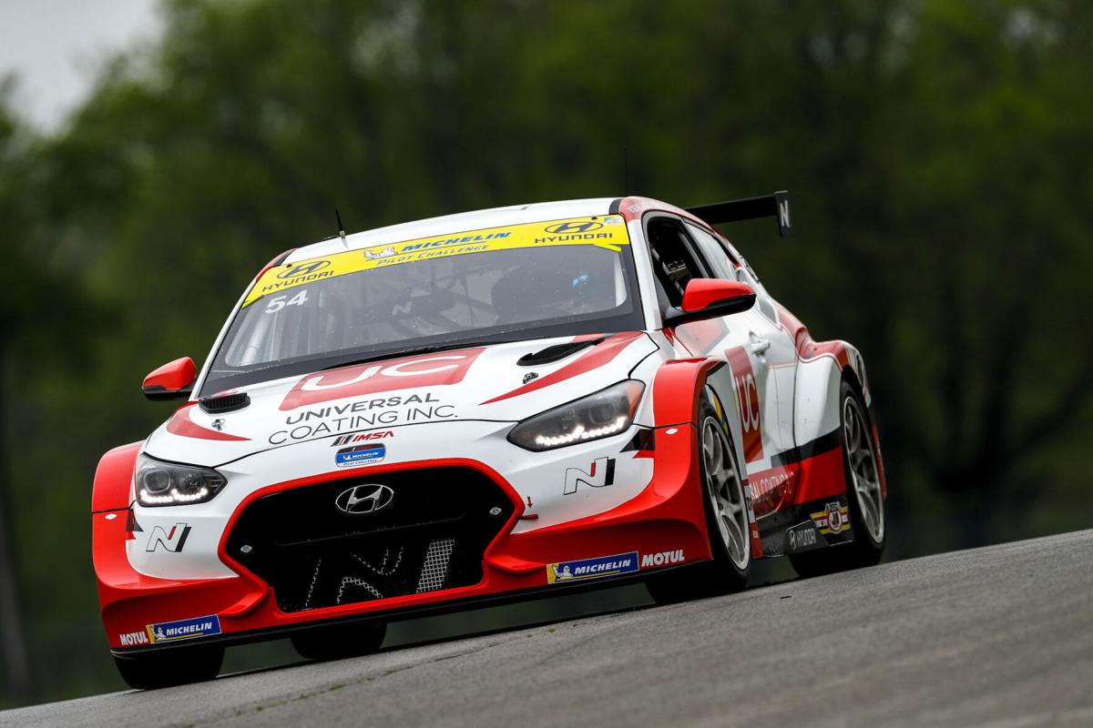 Robert Wickens pilots the Hyundai Veloster N with hand controls.