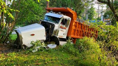 Dump truck crashes through guard rail, ends up in creek in Carbon County