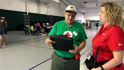 Blind Berks woman surveying Dorian shelters for Red Cross