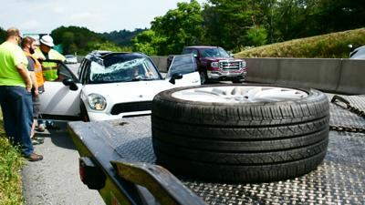 Driver injured when tire comes off car, crosses turnpike, hits windshield