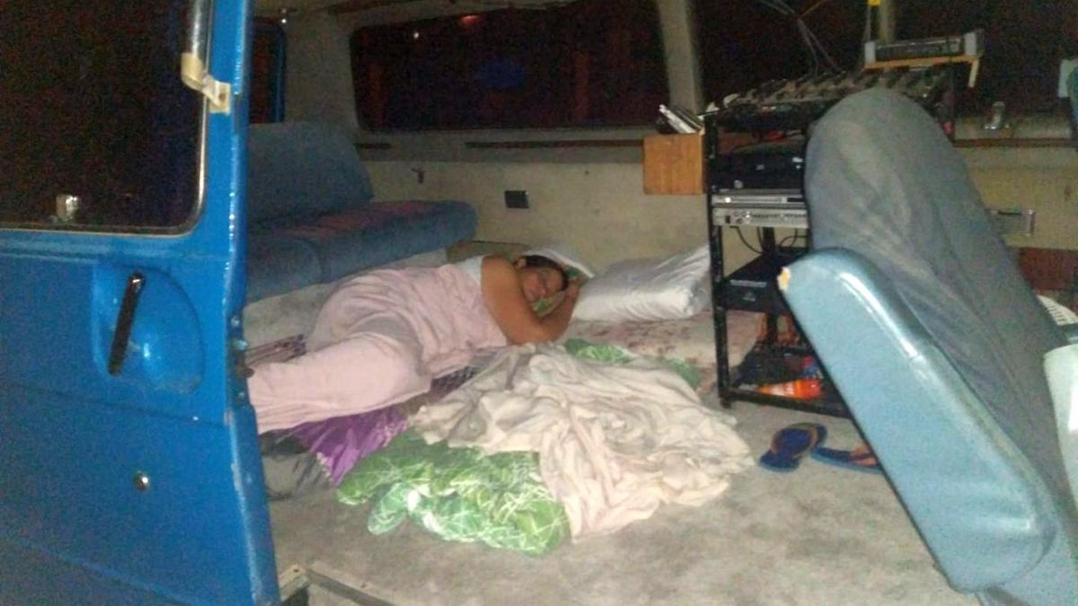 Earthquake evacuee sleeping in van