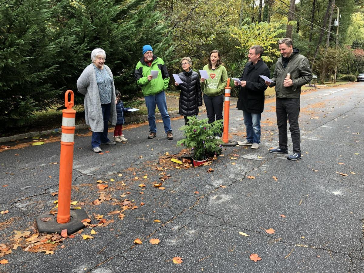 Homeowners put Christmas tree in pothole