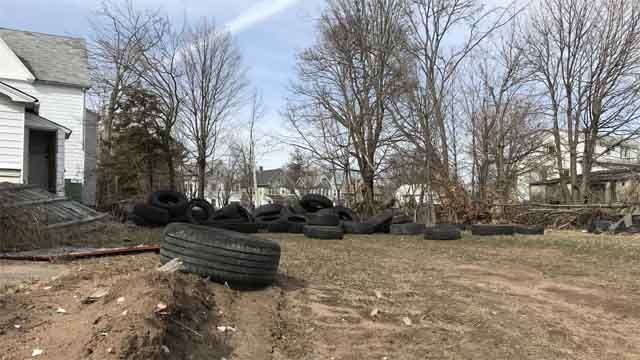 Nearly 100 tires dumped on site of proposed outlet mall