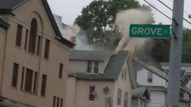 Heavy fire injures 2 firefighters, displaces 5 families in Waterbury