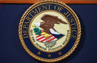 Justice Department limits use of chokeholds and 'no-knock' warrants