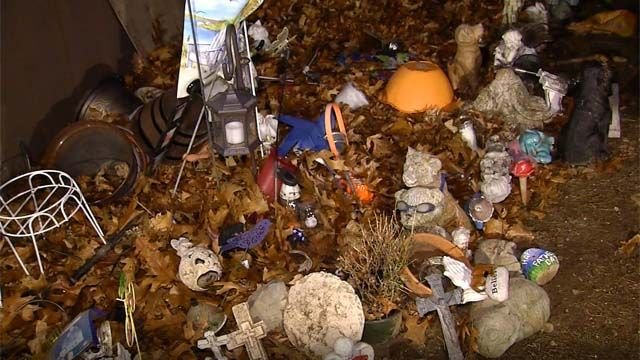 Grave site mementos found in trash pile at Farmington cemetery