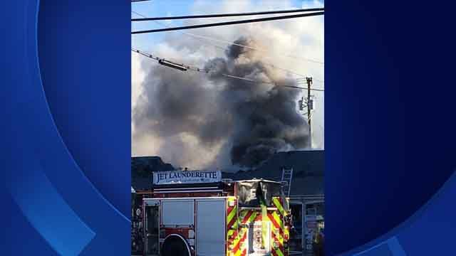 Fire heavily damages laundromat in Westbrook