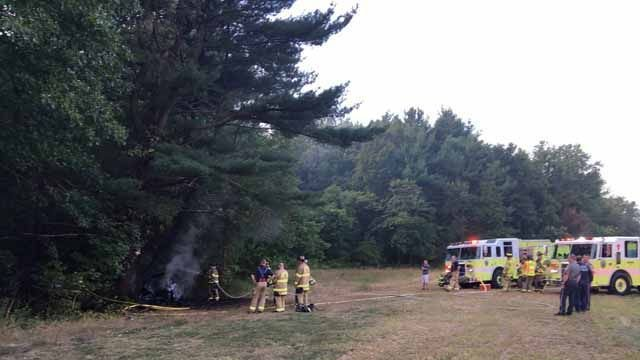 Volunteer firefighter rescues driver from burning car in North Haven