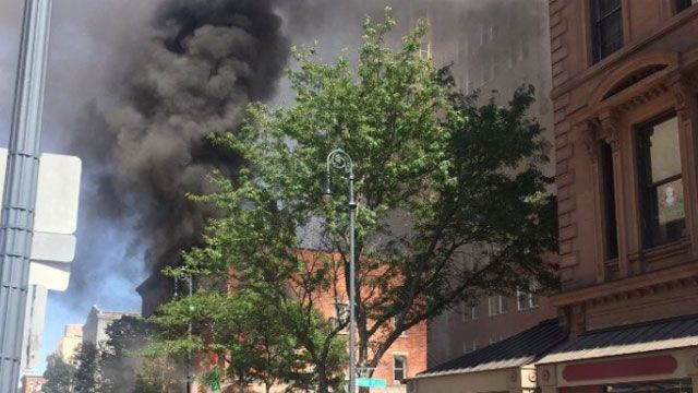 Man rescued from burning building in New Haven
