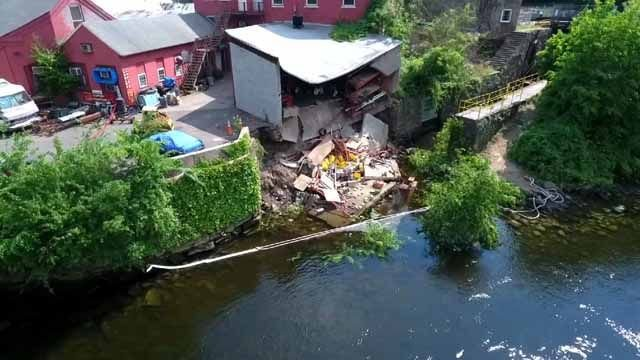Part of Shelton building collapses, lands in river nearby