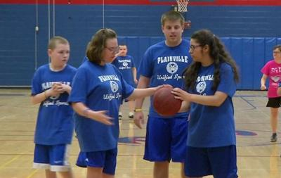 Plainville High School basketball students support each other