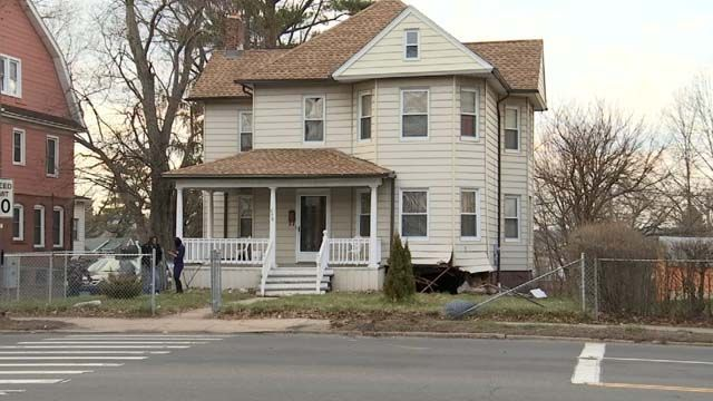 Driver taken to hospital after car crashes into Hartford home