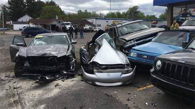 PD: Car crashes into parked cars outside dealership