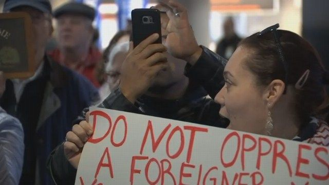 Thousands protest president's travel ban at Bradley Airport, Yale University and Hartford Cathedral