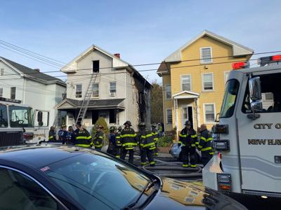 A fire damaged a home and displaced 7 people in New Haven