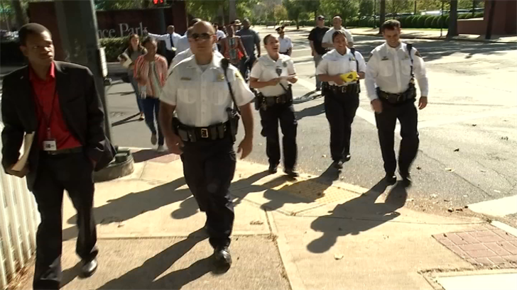 New Haven officers, city employees participate in afternoon stroll