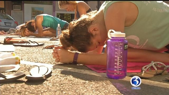 Thousands partake in outdoor yoga in West Hartford