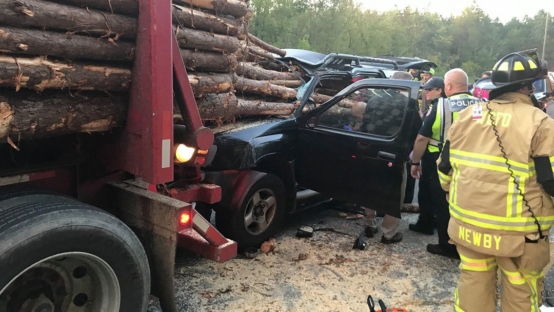 Driver survives after several logs pierce windshield of SUV