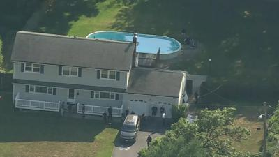An 8-year-old girl, her mother and her grandfather were found dead in the swimming pool of a house they had just moved into