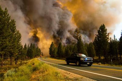 Wildfires prompt evacuations along the West Coast and hazy conditions as far as the East Coast