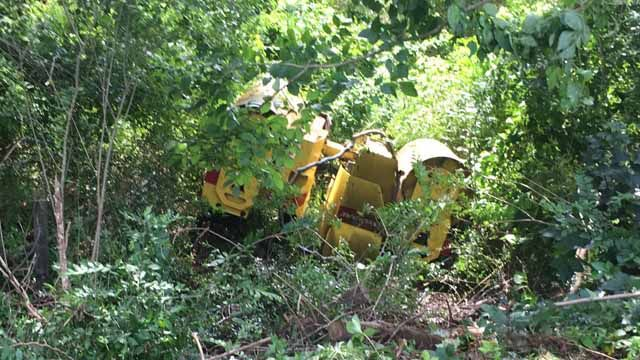 Driver treated after paver rolls down hill